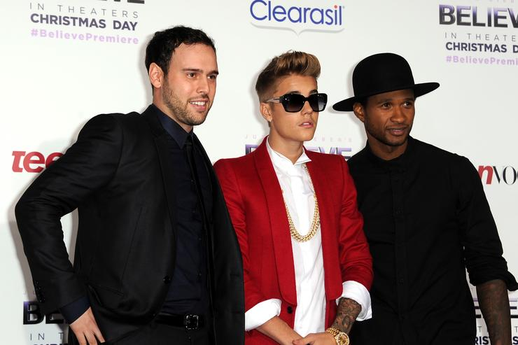 Scooter Braun, singer/producer Justin Bieber and producer Usher arrive at the premiere Of Open Road Films' 'Justin Bieber's Believe' at Regal Cinemas L.A. Live on December 18, 2013 in Los Angeles, California