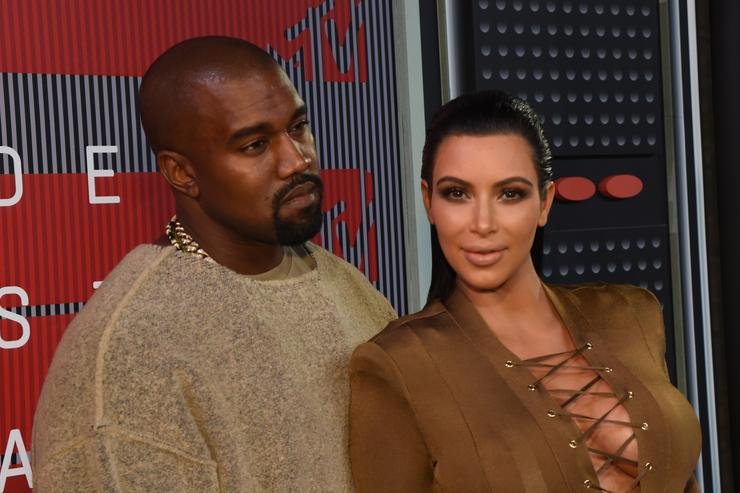 Recording artist Kayne West (L) and TV personality Kim Kardashian attend the 2015 MTV Video Music Awards at Microsoft Theater on August 30, 2015 in Los Angeles, California.