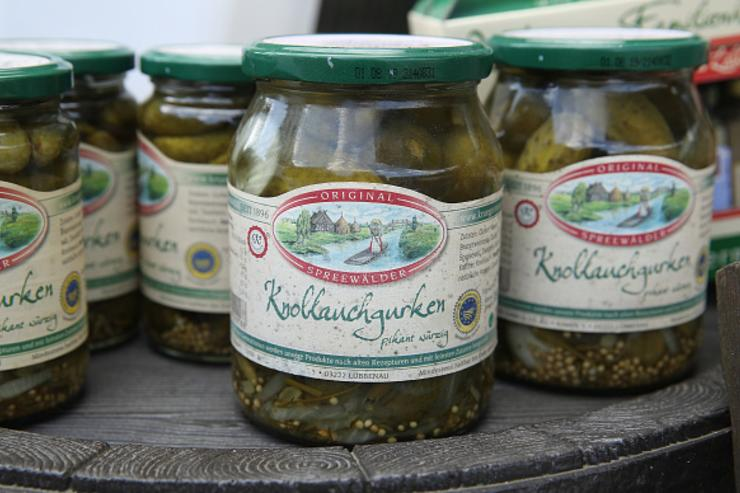 Jars of locally-produced Spreewalder pickles stand on display for sale at a stand in the Spreewald region on April 5, 2018 in Luebbenau, Germany.