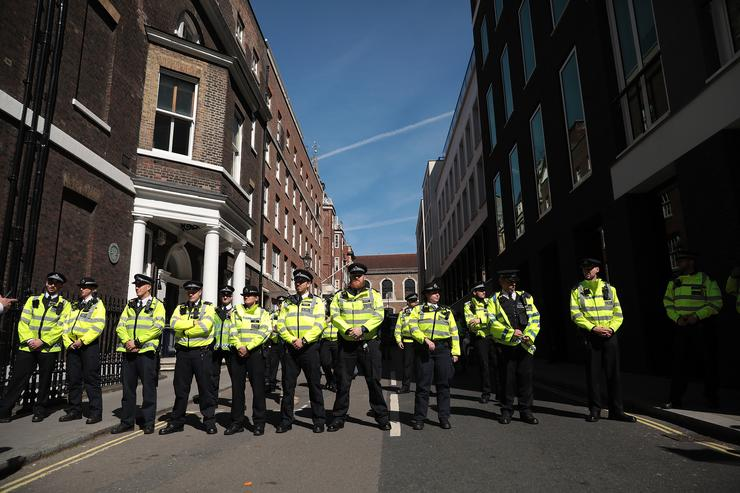 Police officers form a barrier as protesters gather outside Chatham House ahead of a visit by the Turkish President Recep Tayyip Erdogan on May 14, 2018 in London, England. Mr Erdogan arrives to speaks at Chatham House during his three-day visit to the UK, which includes a closing lecture at the Tatlidil Forum in Oxford, an audience with The Queen and talks with British Prime Minister Theresa May.