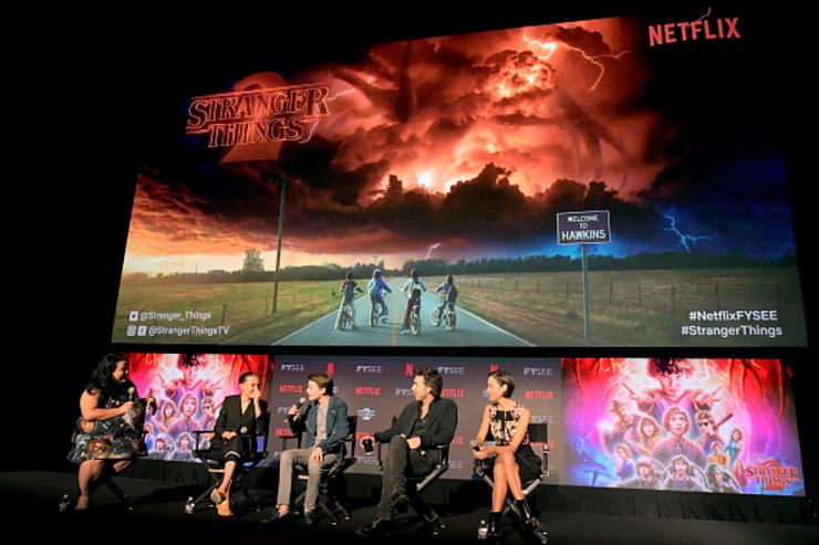Moderator Jenelle Riley, Millie Bobby Brown, Noah Schnapp, Director Shawn Levy and Casting Director Carmen Cuba speak onstage at The 'Stranger Things 2' Panel At Netflix FYSEE on May 19, 2018 in Los Angeles, California.
