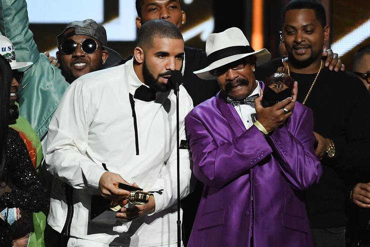 Drake (L) accepts the Top Artist award onstage with his father Dennis Graham during the 2017 Billboard Music Awards at T-Mobile Arena on May 21, 2017 in Las Vegas, Nevada