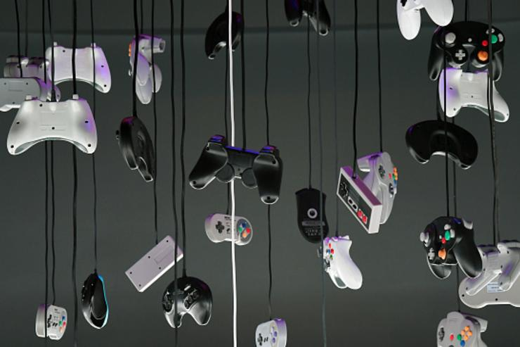 Gaming controllers hang over a gaming station room during the grand opening of Esports Arena Las Vegas the first dedicated esports arena on the Las Vegas Strip at Luxor Hotel and Casino