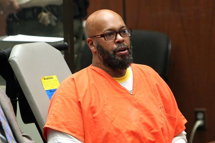Marion 'Suge' Knight appears in court with his Lawyer Matthew P Fletcher for a preliminary hearing in a robbery charge case at Criminal Courts Building on April 8, 2015 in Los Angeles, California. Knight is charged with robbery and criminal threats after allegedly stealing a photographer's camera during an incident September 5, 2014 in Beverly Hills.