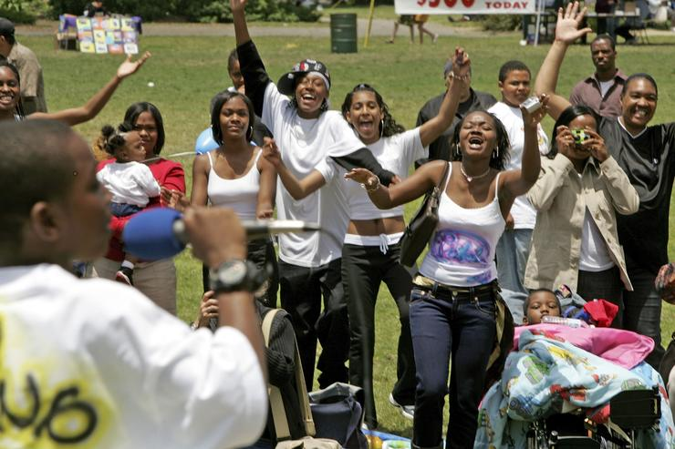 People attend Juneteenth, Black Independence Day celebrations at Nichol Park on June 19, 2004 in Richmond, California. The holiday is celebrated in June because slaves in Texas and several other states did not learn of their freedom until June of 1865.