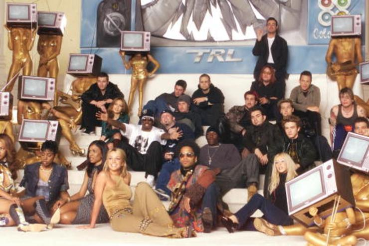 The 'TRL' class photo will be turned into a poster and sold via MTV.com with proceeds going to charity. Artists participating in the shoot included Britney Spears, 'NSYNC, Jennifer Lopez, Limp Bizkit, Christina Aguilera, Puff Daddy, Lenny Kravitz, Tyrese, Destiny's Child and Goo Goo Dolls.