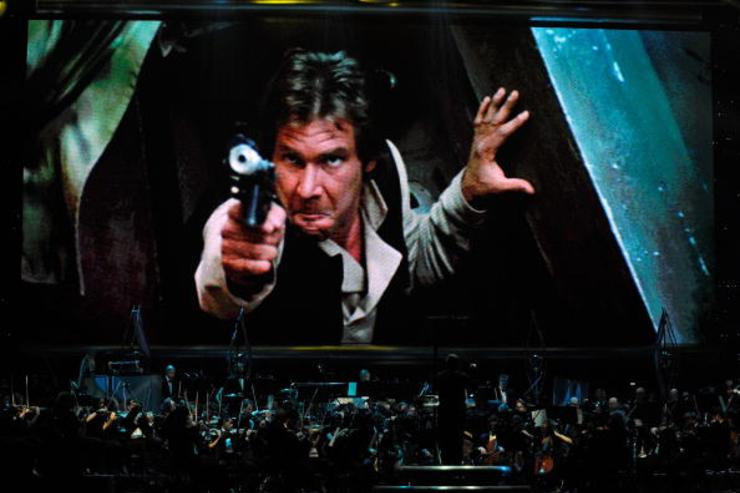 Actor Harrison Ford's Han Solo character from 'Star Wars Episode VI: Return of the Jedi' is shown on screen while musicians perform during 'Star Wars: In Concert' at the Orleans Arena May 29, 2010 in Las Vegas, Nevada.