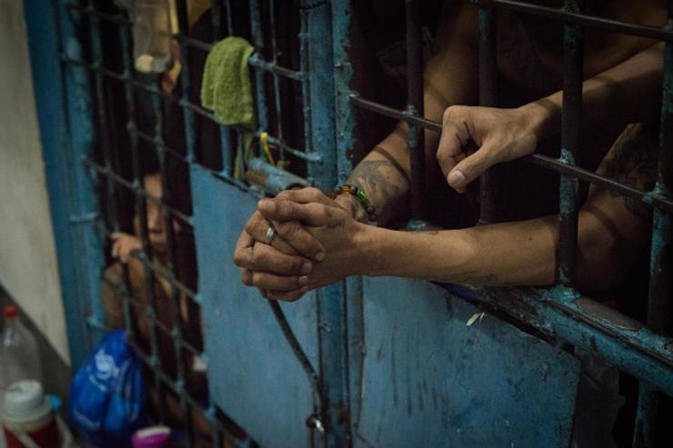 Inmates stay inside an overcrowded jail cell inside a police precint jail on December 15, 2016 in Manila, Philippines.