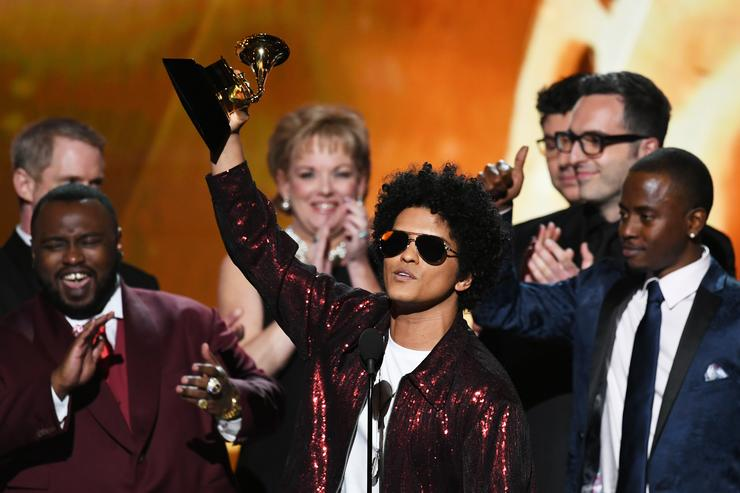 Recording artist Bruno Mars (C) accepts Album of the Year for '24K Magic' with production team onstage during the 60th Annual GRAMMY Awards at Madison Square Garden on January 28, 2018 in New York City.