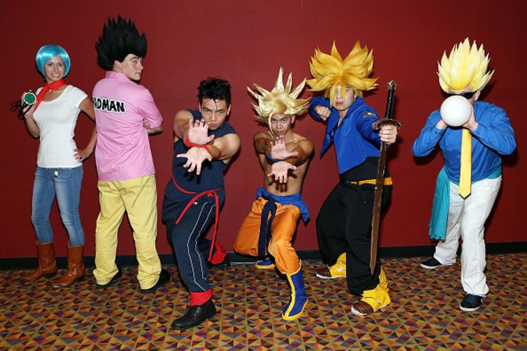 Guests dressed as characters from the movie pose for a photo at the 'Dragon Ball Z: Resurrection 'F'' New York theatrical premiere at AMC Empire on August 3, 2015 in New York City.