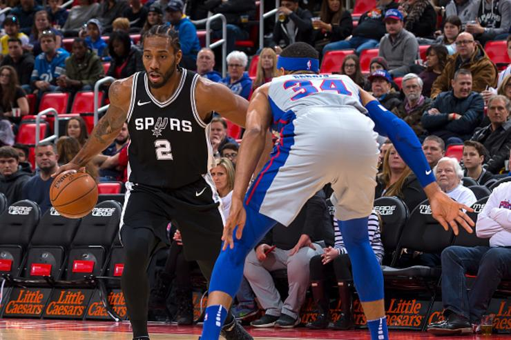 Tobias Harris #34 of the Detroit Pistons defends against Kawhi Leonard #2 of the San Antonio Spurs in the first half of an NBA game at Little Caesars Arena on December 30, 2017 in Detroit, Michigan.