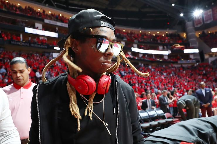 Artist Lil Wayne attends Game Two of the Western Conference Finals of the 2018 NBA Playoffs between the Houston Rockets and the Golden State Warriors at Toyota Center on May 16, 2018 in Houston, Texas.