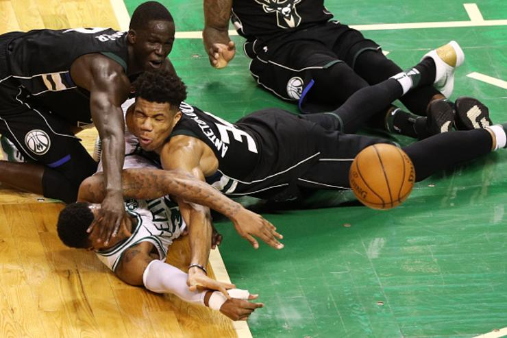 Marcus Smart #36 of the Boston Celtics competes for a loose ball against Giannis Antetokounmpo #34 of the Milwaukee Bucks and Thon Maker #7 during the fourth quarter in Game Five in Round One of the 2018 NBA Playoffs at TD Garden on April 24, 2018 in Boston, Massachusetts.