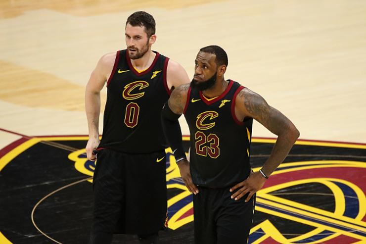 Kevin Love #0 and LeBron James #23 of the Cleveland Cavaliers look on in the first half against the Boston Celtics during Game Three of the 2018 NBA Eastern Conference Finals at Quicken Loans Arena on May 19, 2018 in Cleveland, Ohio.