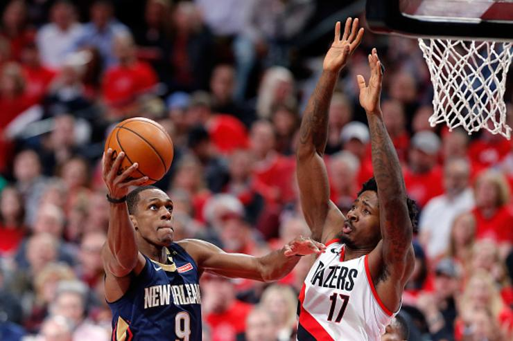 Rajon Rondo #9 of the New Orleans Pelicans drives against Ed Davis #17 of the Portland Trail Blazers during Game One of the Western Conference Quarterfinals during the 2018 NBA Playoffs at Moda Center on April 17, 2018 in Portland, Oregon.