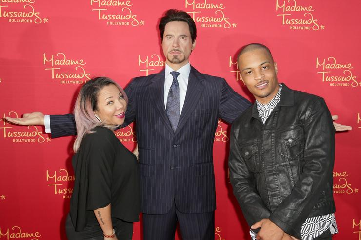 Tiny (L) and rapper TI pose with Madame Tussauds Hollywood's figures at the 'Avengers: Age of Ultron' premiere at Dolby Theatre on April 13, 2015 in Hollywood, California