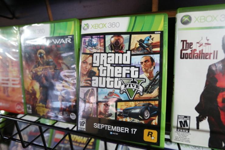 A display copy of Grand Theft Auto V (C) sits on a shelf at the 8 Bit & Up video games shop in Manhattan's East Village on September 18, 2013 in New York City. The video game raked in more than $800 million in sales in its first 24 hours on the shelves