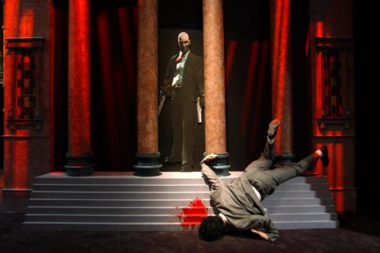 A life-size grisly murder scene draws attention to the exhibit of the violent video game, 'Hitman 2 Silent Assassin', on the first day of E3, the Electronic Entertainment Expo, May 22, 2002 at the Los Angeles Convention Center in Los Angeles, CA