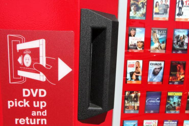 : A RedBox video rental kiosk sits in front of a gas station August 14, 2009 in San Rafael, California. Movie studios are making an attempt to limit new release movies to the fast growing DVD rental kiosk company RedBox in protest of their extremely low rental prices.