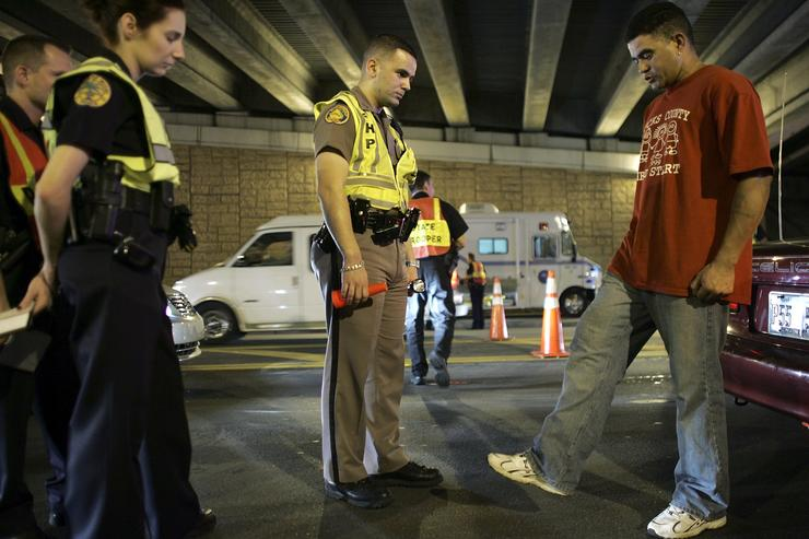 Trooper, David Casillas, (C) from the Florida Highway Patrol conducts a field sobriety test at a DUI checkpoint December 15, 2006 in Miami, Florida. The city of Miami, with the help of other police departments, will be conducting saturation patrols and setting up checkpoints during the holiday period looking to apprehend drivers for impaired driving and other traffic violations.