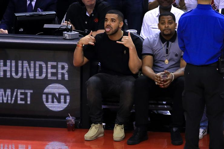 Drake reacts while sitting courtside in the first half of game four of the Eastern Conference Finals between the Cleveland Cavaliers and the Toronto Raptors during the 2016 NBA Playoffs at the Air Canada Centre on May 23, 2016 in Toronto, Ontario, Canada