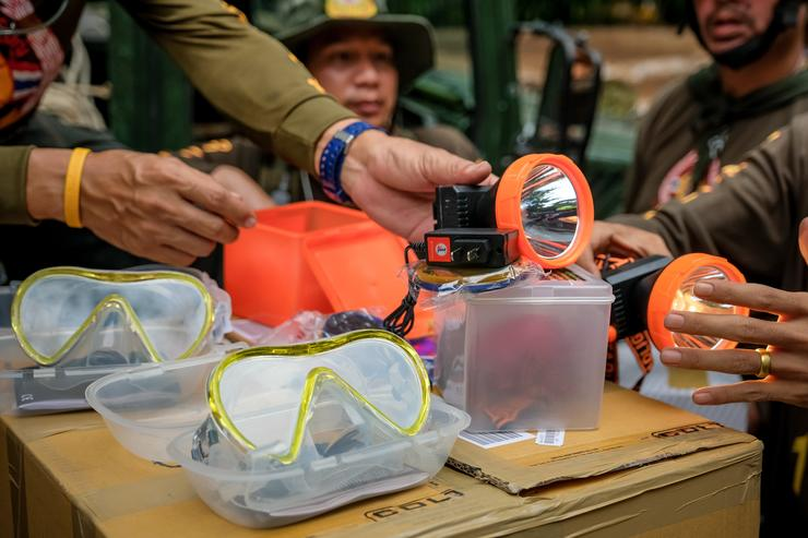 Rescuer workers prepare small diving mask to deliver inside Tham Luang Nang Non cave to continue the rescue operation on July 04, 2018 in Chiang Rai, Thailand. The 12 boys and their soccer coach have been found alive in the cave here theyve bee missing for over a week after monsoon rains blocked the main entrance in northern Thailand. Videos released by the Thai Navy SEAL shows the boys, aged 11 to 16, and their 15-year-old coach are in good health in Tham Luang Nang Non cave and the challenge now will be to extract the party safely.