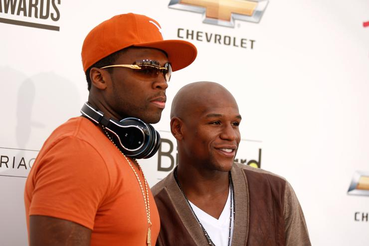 50 Cent and boxer Floyd Mayweather, Jr. arrive at the 2011 Billboard Music Awards at the MGM Grand Garden Arena May 22, 2011 in Las Vegas, Nevada