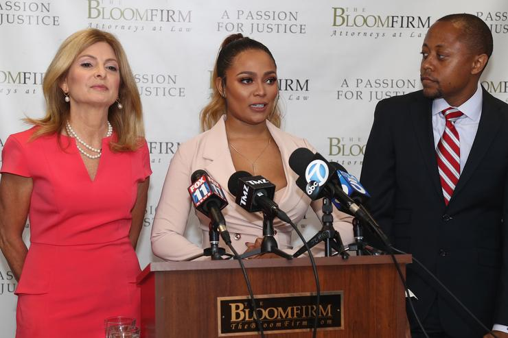 Teairra Mari (C) and her attorneys Lisa Bloom (L) and Walter Mosely speak during a press conference about new legal action against rapper 50 Cent and Akbar Abdul-Ahad at The Bloom Firm on May 17, 2018 in Woodland Hills, California