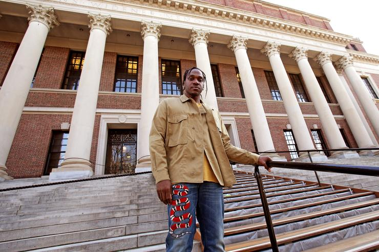 Rapper Pusha T poses outside the Widener Library on March 31, 2016 at Harvard University in Cambridge, Massachusetts.
