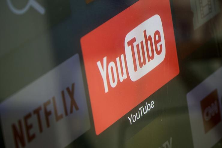 The YouTube and Netflix app logos are seen on a television screen on March 23, 2018 in Istanbul, Turkey. The Government of Turkish President Recep Tayyip Erdogan passed a new law on March 22 extending the reach of the country's radio and TV censor to the internet.