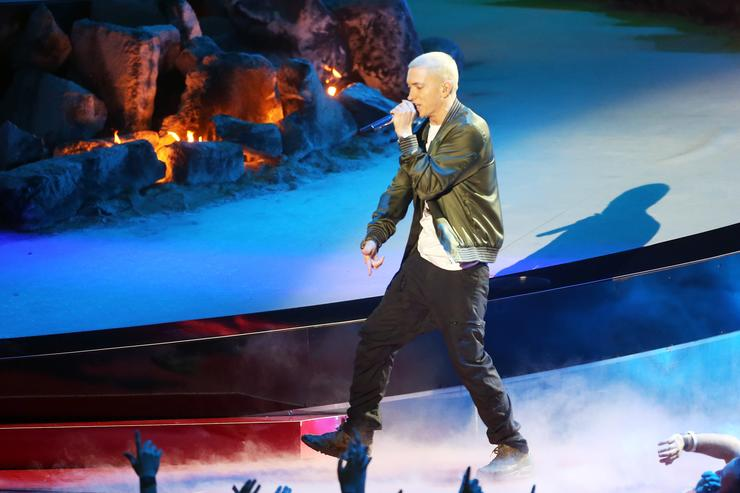 Rapper Eminem performs onstage at the 2014 MTV Movie Awards at Nokia Theatre L.A. Live on April 13, 2014 in Los Angeles, California.