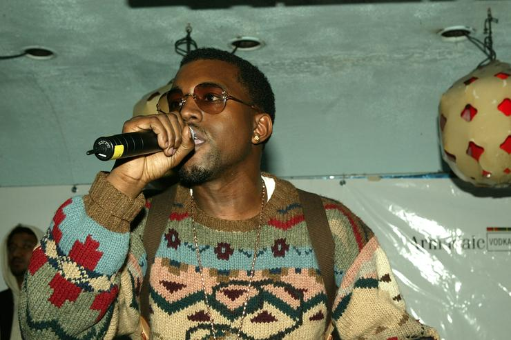Kanye West performs at the Lifebeat Hearts and Voices benefit for AIDS research on March 11, 2004 at Float, in New York City