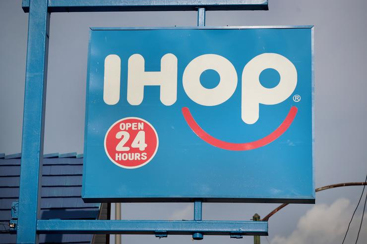 : An IHOP restaurant serves customers on August 10, 2017 in Chicago, Illinois. DineEquity, the parent company of Applebee's and IHOP, plans to close up to 160 restaurants in the first quarter of 2018. The announcement helped the stock climb more than 4 percent today.