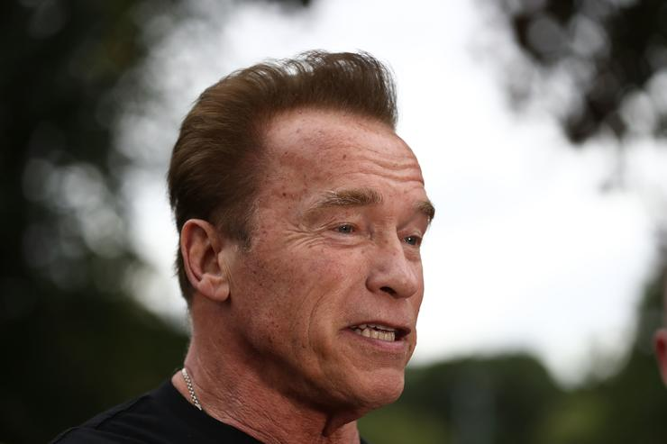 Arnold Schwarzenegger speaks to the media as he prepares to start the Run for the Kids charity run as part of the Arnold Sports Festival Australia at the Alexander Gardens