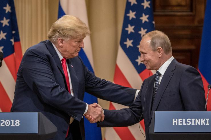 President Donald Trump (L) and Russian President Vladimir Putin shake hands during a joint press conference after their summit on July 16, 2018 in Helsinki, Finland. The two leaders met one-on-one and discussed a range of issues including the 2016 U.S Election collusion.