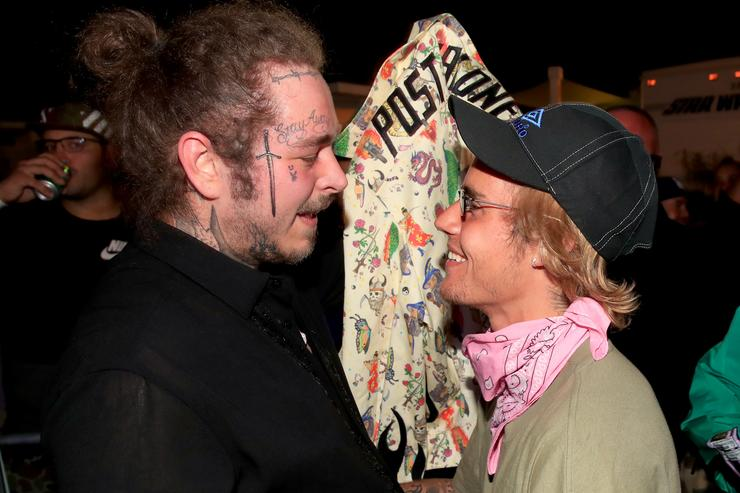 Post Malone and Justin Bieber speak backstage during 2018 Coachella Valley Music And Arts Festival Weekend 1 at the Empire Polo Field on April 14, 2018 in Indio, California.