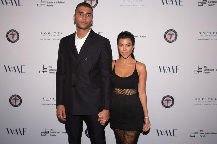Younes Bendjima (L) and Kourtney Kardashian arrive for The Syrian American Medical Society hosts the Voices in Displacement Gala at Riviera 31 at Sofitel on May 4, 2018 in Los Angeles, California.