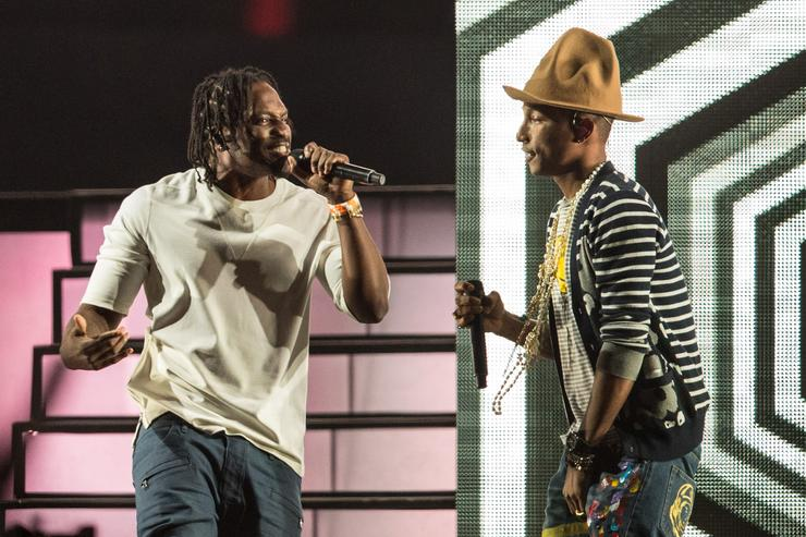 Rapper Pusha T and singer Pharrell Williams perform onstage during day 2 of the 2014 Coachella Valley Music & Arts Festival at the Empire Polo Club on April 19, 2014 in Indio, California.