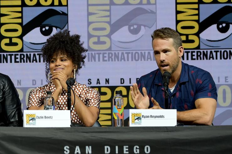 Zazie Beetz (L) and Ryan Reynolds speak onstage at the 'Deadpool 2' panel during Comic-Con International 2018 at San Diego Convention Center on July 21, 2018 in San Diego, California.