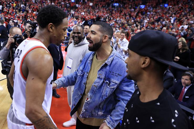 Drake congratulates DeMar DeRozan #10 of the Toronto Raptors following Game Seven of the Eastern Conference Quarterfinals against the Indiana Pacers during the 2016 NBA Playoffs at the Air Canada Centre on May 01, 2016 in Toronto, Ontario, Canada