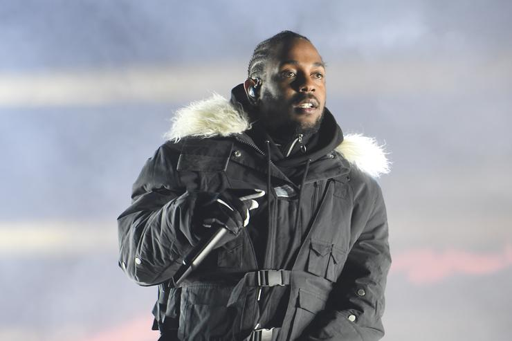 Kendrick Lamar performs during half time during 2018 College Football Playoff National Championship Game at Centennial Olympic Park on January 8, 2018 in Atlanta, Georgia