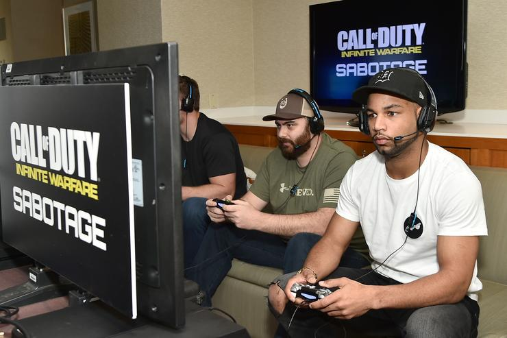 Pro football players Golden Tate and Joey Bosa play Call of Duty: Infinite Warfare Sabotage DLC with Hike the Gamer on February 1, 2017 in Houston, Texas.