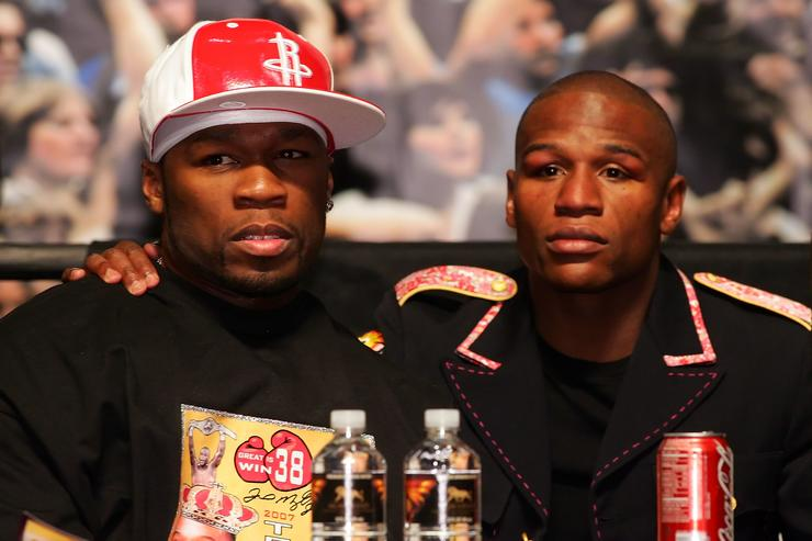 50 Cent and Floyd Mayweather Jr. embrace during the post-fight news conference after Mayweather defeated Oscar De La Hoya by split decision after their WBC super welterweight championship fight at the MGM Grand Garden Arena May 5, 2007 in Las Vegas, Nevada