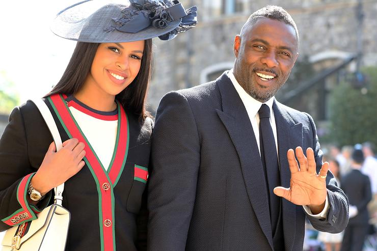 Idris Elba and Sabrina Dhowre arrive at St George's Chapel at Windsor Castle before the wedding of Prince Harry to Meghan Markle on May 19, 2018 in Windsor, England.