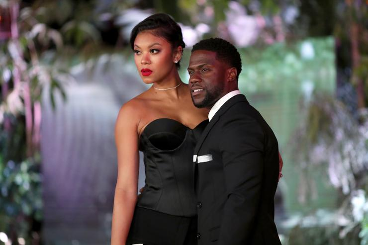 Eniko Parrish (L) and Kevin Hart attend the premiere of Columbia Pictures' 'Jumanji: Welcome To The Jungle' on December 11, 2017 in Hollywood, California