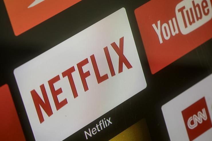 The Netflix App logo is seen on a television screen on March 23, 2018 in Istanbul, Turkey. The Government of Turkish President Recep Tayyip Erdogan passed a new law on March 22 extending the reach of the country's radio and TV censor to the internet