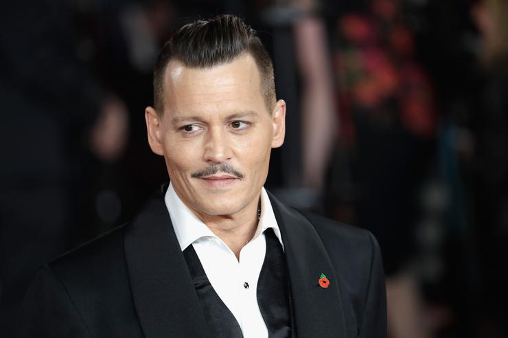 Johnny Depp attends the 'Murder On The Orient Express' World Premiere at Royal Albert Hall on November 2, 2017 in London, England.