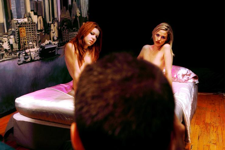 Amateur models are photographed by artist and adult filmmaker Irvin Bomb, center, before shooting a pornographic video December 15, 2000 in New York. Research groups predict that Web porn will rise to a $366 million business by 2001, 10 percent of all online retailing.