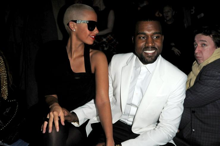 Kanye West and Amber Rose attend the Givenchy Fashion Show during Paris Fashion Week Haute Couture S/S 2010 on January 26, 2010 in Paris, France.