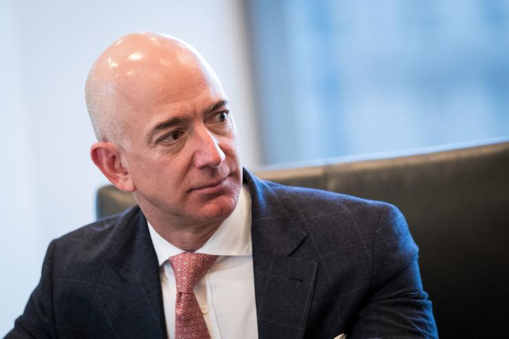 Jeff Bezos, chief executive officer of Amazon, listens during a meeting of technology executives and President-elect Donald Trump at Trump Tower, December 14, 2016 in New York City. This is the first major meeting between President-elect Trump and technology industry leaders.